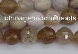 CAG9854 15.5 inches 8mm faceted round ocean fossil agate beads
