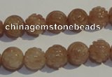 CBQ14 15.5 inches 10mm carved round strawberry quartz beads