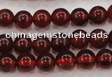 CGA601 15.5 inches 6mm A grade round natural orange garnet beads