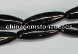 CJB54 15.5 inches 10*30mm rice natural jet gemstone beads