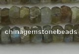 CNG5752 15.5 inches 6*9mm faceted nuggets labradorite beads
