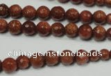 CRO736 15.5 inches 6mm – 14mm faceted round goldstone beads