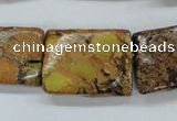 CSE148 18*25mm twisted rectangle dyed natural sea sediment jasper beads