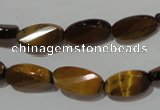 CTE1097 15.5 inches 8*15mm twisted & faceted oval yellow tiger eye beads