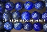 CTG3575 15.5 inches 4mm faceted round lapis lazuli beads